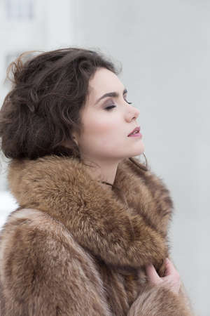 Love. Affectionate Dreamy Sensual Woman in Fur Coat in Reverie. Serene photo