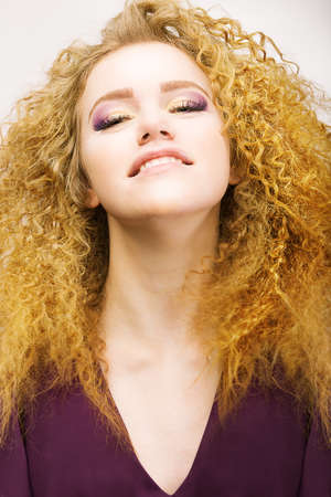 frizzy: Youth. Beauty Portrait Of Frizzy Red Hair Woman closeup. Pretty Smile