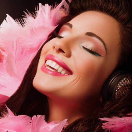 Inspiration  Fancy Cheerful and Happy Woman with pink Feathers smiling  Pleasure photo