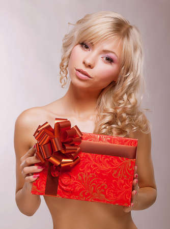 sexy birthday: Young Beauty Blonde holding Red Box as a Present  Holiday Stock Photo