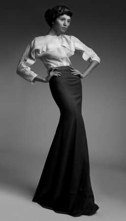 sophistication: Elegance  Luxurious Genuine Lady in Classic Long Black Dress  Aristocracy