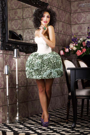 Luxury  Stylish Brunette standing in Trendy Dress  Modern Interior photo