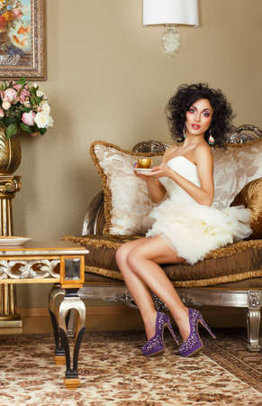 Luxurious Lady sitting on Retro Couch with Cap of Coffee  Classic Interior Stock Photo - 18767451