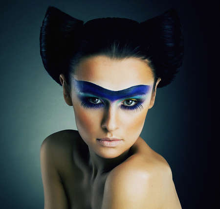 Haute Couture  Fantasy  Classy Woman with Blue Painted Mask and Modern Hairstyle photo