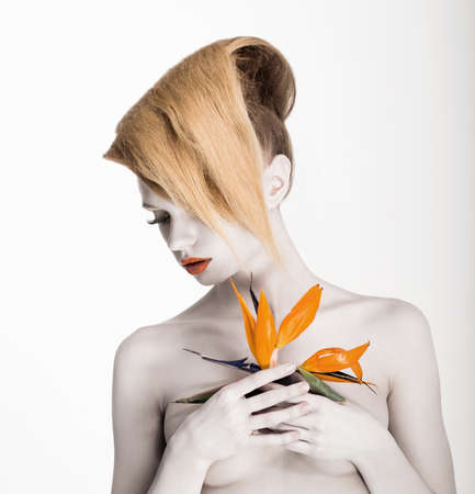 nude fashion model: Fantasy  Artistry  Futuristic Woman with Yellow Flower  Trendy Coiffure, Bodyart Make-up