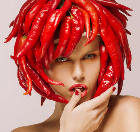 red jalapeno: Glamour  Hot Chili Pepper on Shiny Woman Stock Photo