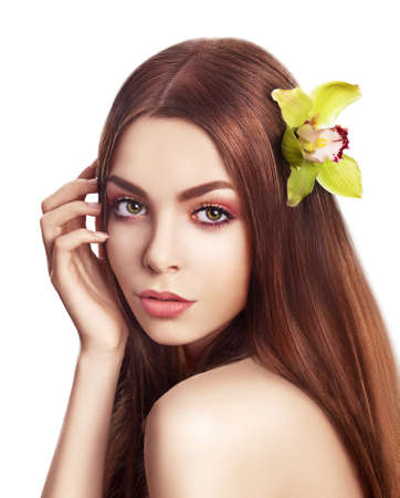 Pampering  Serene Woman with Orchid Fresh Flower in Hair  Tenderness photo