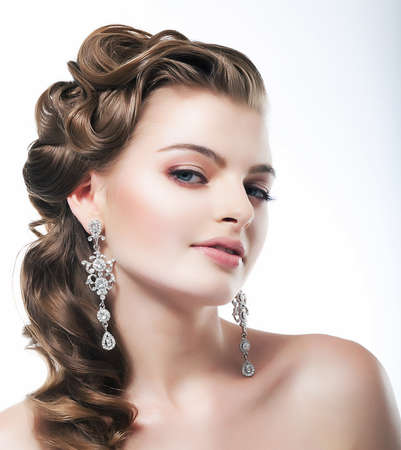 silver jewelry: Delight. Elegant Posh Woman Bride with Diamond Earrings. Platinum Jewelry