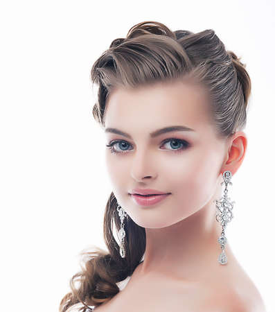 Jewelry. Glamorous Smiling Brunette with Brilliant Earrings. Sophistication