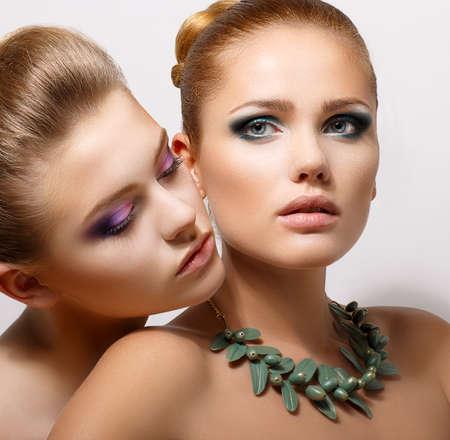 foreplay: Bonding  Allure  Faces of Two Sensual Pretty Women Closeup  Aspiration