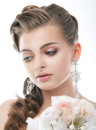 beautiful bride: Love. Romantic Sophisticated Woman with Bouquet of Flowers. Freshness & Tenderness