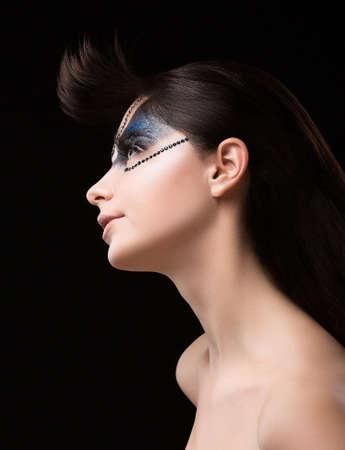 nifty: Haute Couture. Futuristic Brunette with Metallic Rhinestones. Fantastic Unusual Makeup