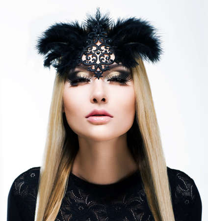 flirtatious: Charm. Delightful Blond Hair Woman with Plaits and Black Mask. Refinement