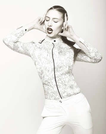 Charisma. Peculiar Emotional Woman in White. Fantasy photo