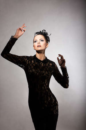 elated: Charm. Elated Delightful Woman in Stylized Black Dress. Nostalgia Stock Photo