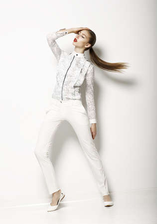 Contemporary Clothing Design. Modish Woman in White Blouse and Pants. Fashion Stock Photo - 19024963