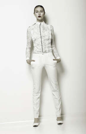 white pants: Trend. New Summer Apparel Collection. Woman wearing White Clothing.