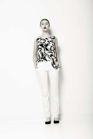 Glamour  Fashion Model in Modern White Trousers and Shirt  Elegance photo