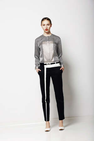 nifty: Attitude  Glamor  Fashion Model in Modern Grey Costume  Spring Time Collection  Trend Stock Photo