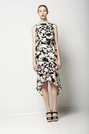 Springtime Collection  Elegant Slender Woman in Stylish Dress  Trendy Fashion Model Stock Photo