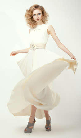 Femininity. Fashion Model in Long Light Dress. Smart Casual Clothes. Summertime Collection photo