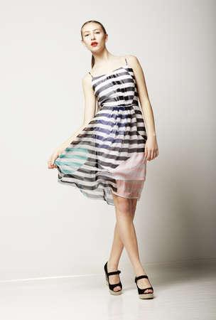 Lifestyle. Attractive Slim Female wearing Sleeveless Tabby Dress. Sensuality Stock Photo - 19146422