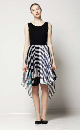 Full Length of Modish Woman in Strippy Dress. Springtime Workday Collection photo