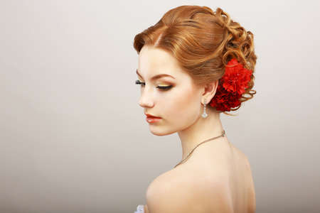 Daydream. Tenderness. Golden Hair Female with Red Flower. Platinum Shine Necklace Stock Photo