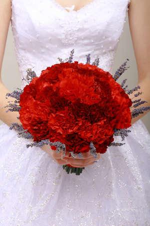 felicitation: Donation. Compliment.Vernal Bouquet of Red Flowers in Womans hands. Felicitation