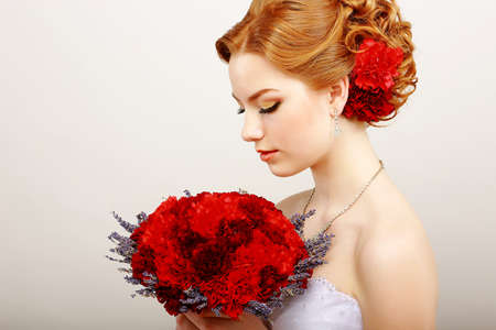 gentleness: Mildness. Profile of Calm Woman with Red Bouquet of Flowers. Tranquility & Gentleness Stock Photo