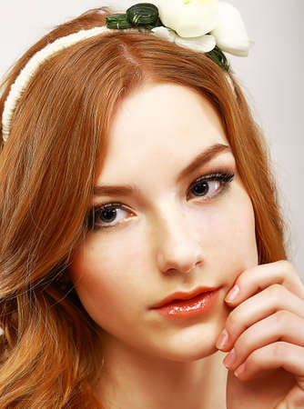 purity: Goodness. Portrait of Young Meek Woman with White Flower on her Head Stock Photo
