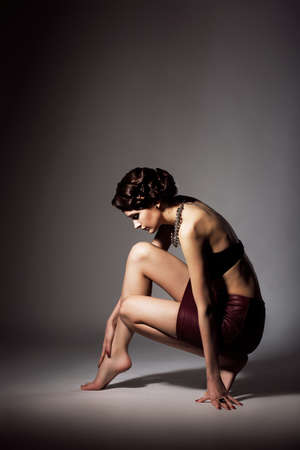 bended: Femininity  Voluptuous Barefoot Pensive Woman sitting on Tiptoe  Grace