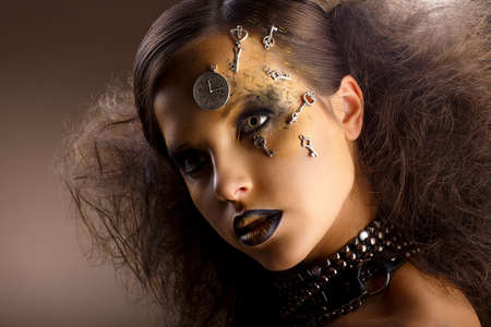 Artistry  Extraordinary Shiny Woman in Shadows  Golden Makeup  Creativity photo