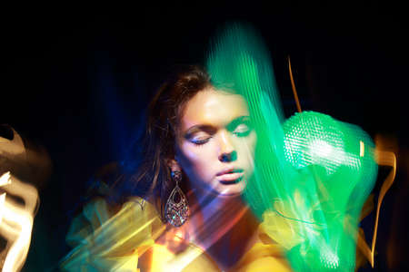 metamorphose: Flutter  Face of Woman in Blurry Colorful Lights  Metamorphose Stock Photo