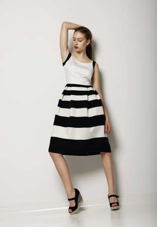 high contrast: Individualism. Confident Young Woman in Contrast Light Sundress