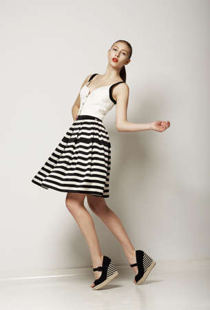 twiggy: Fashion Style. Happy Young Shopper in Contrast Striped Grey Skirt. Movement