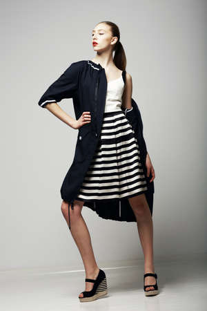 slicker: Ambitions. Confident Honorable Brunette in Black Waterproof Mackintosh. Vogue Style