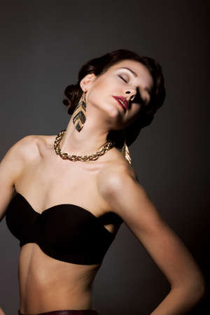 chainlet: Bliss. Sultry Graceful Beauty in Black Bra with Golden Jewelery - Necklace and Earrings