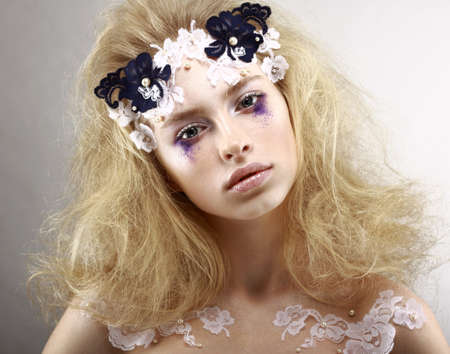 Young Styled Blonde with Colorful Makeup - Blue Eye Shadows. Arts Stock Photo - 19339400