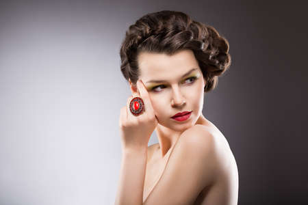 Noble Lady. Gorgeous Posh Brunette with Jewelry - Ruby Oval Ring. Braided Hairstyle photo