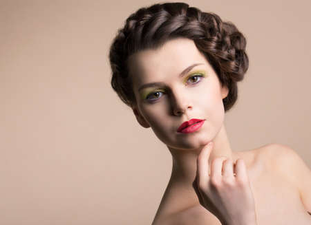 chic woman: Retro Styling. Genuine Nostalgic Chic Woman with Plaited Brown Hair. Plait Stock Photo
