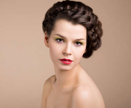 Femininity. Nostalgia. Retro Styled Pinup Girl with Brown Braided Hair. Romance photo