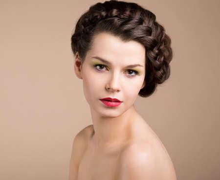 Femininity. Nostalgia. Retro Styled Pinup Girl with Brown Braided Hair. Romance Stock Photo - 19339627