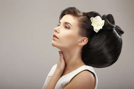 Hairstyle Contemporary Design. Sensual Woman with Creative Coiffure. Glamor photo