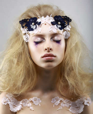 Relax. Styled Enigmatic Blonde with Painted Skin. Dreams with Closed Eyes. Beauty photo