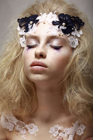 Imagination. Tranquility. Portrait Dreaming Teen Girl with Fantastic Makeup photo
