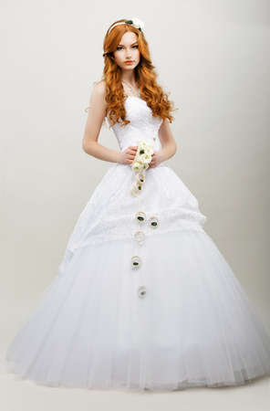 Tenderness. Redhaired Exquisite Bride in White Bridal Dress. Wedding Fashion Collection photo