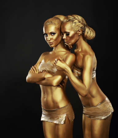 Bodyart. Girlfriends with Golden Makeup in Embrace. Art Deco Stock Photo - 19380992