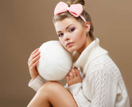 Hosiery. Beautiful Teen in Handmade Woven Sweater with White Ball of Yarn