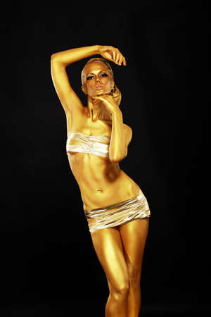Gilding  Portrait of Sexy Woman with Shining Golden Plated Body  Expression Stock Photo - 19363485